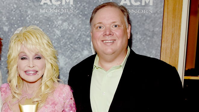 Danny Nozell of CTK Management, Reba McEntire, Dolly Parton and Kirt Webster of Webster Media attend the 11th Annual ACM Honors at the Ryman Auditorium Aug. 23, 2017 in Nashville.