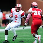 Sep 26, 2015; Bowling Green, KY, USA; Western Kentucky Hilltoppers wide receiver Taywan Taylor (2) carries the ball away from Miami (Oh) Redhawks defensive back Brison Burris (35) during the first half at Houchens Industries-L.T. Smith Stadium. Mandatory Credit: Joshua Lindsey-USA TODAY Sports