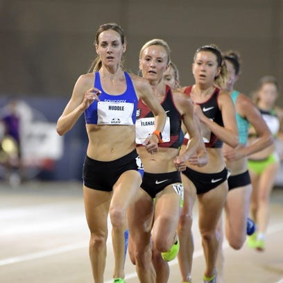 Molly Huddle wins the women's 10,000 meters in 31:19.86