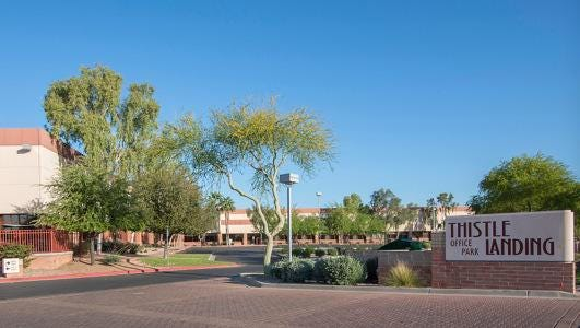 Menlo Equities paid $16.75 million for a 101,006 square-foot office building in Thistle Landing Office Park in Phoenix.