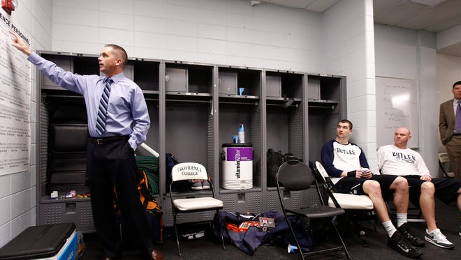 Butler coach Chris Holtmann goes over key points during pregame of the Bulldogs' game at Providence this season.