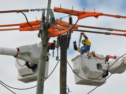 ELECTRIC CREWS RESTORE POWER AFTER HURRICANE MATTHEW
