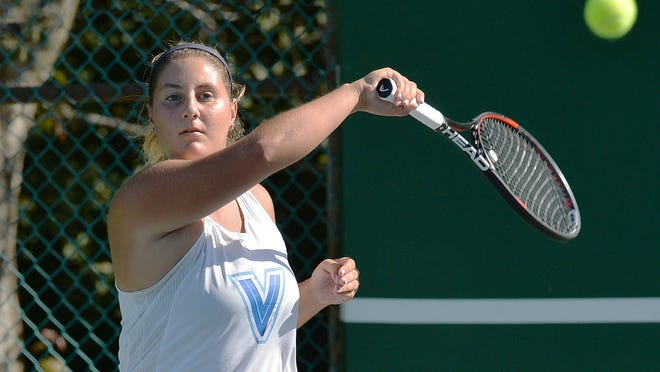 Villa Maria Academy senior Tara Thomas returns a shot during a match with Erie High at Frontier Park on Sept. 3 in Erie. Thomas will compete in the District 10 tennis and PIAA golf postseasons.