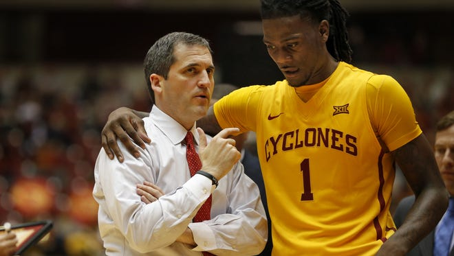 Iowa State coach Steve Prohm talks with Jameel McKay during the Cyclones' game against Chicago State at Hilton Coliseum Monday.