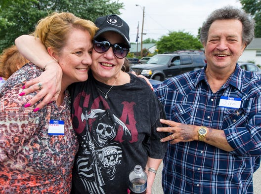 Terri Stevens, left, stepdaughter of Jim Mahaney, right, greets Donna Swanberg as she returns to Indiana for the reunion — her first time back to the state in 30 years. The Mahaney family reunited, Saturday, August 9, 2014, after 30 years of separation. The group of over 100 relatives gathered at Franklin Park in Plainfield.