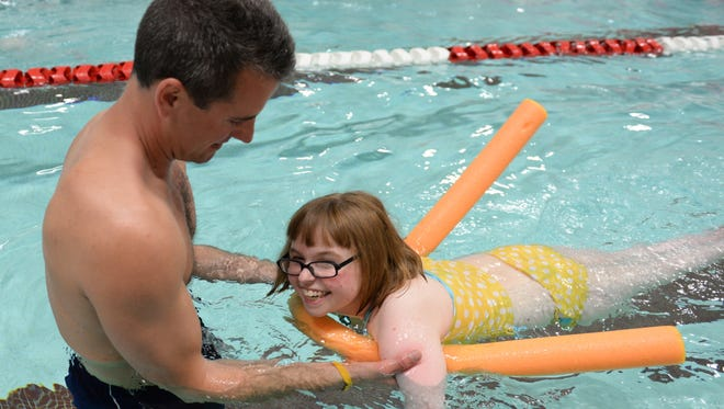 Morgan Bornhofer of Pulaski swims her six lengths of the Pulaski Middle School pool during the Goody Triathlon in Pulaski.