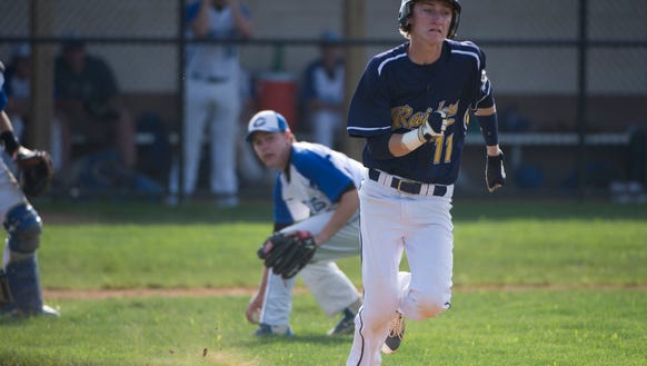 Elco's Kyle Rosengrant attempts to beat out a bunt.