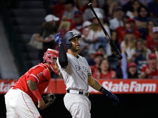 Aaron Hicks remained out of the Yankees' lineup for a second straight game, Saturday but he hasn't been ruled out for Sunday's series finale.