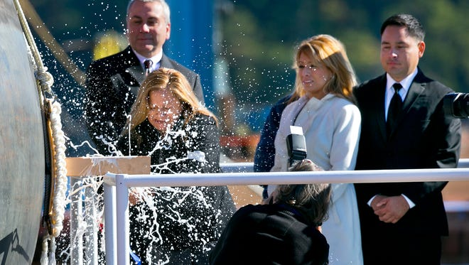 Rosa Peralta smashes a bottle of Champagne Oct. 31, 2015, to christen the USS Rafael Peralta. The warship is named for Rosa Peralta's son, Sgt. Rafael Peralta, killed in action Nov. 15, 2004, while clearing houses in the city of Fallujah, Iraq, during Operation Al Fajr.