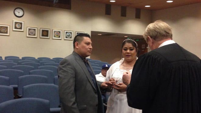 Eden Lopez, left, and Claudia Duran, both of Oxnard, exchanged vows before Superior Court Judge Henry Walsh late last year at the Ventura County Government Center.
