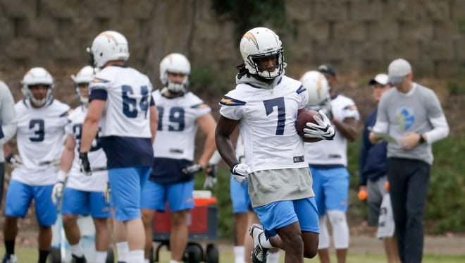 San Diego Chargers rookie Mike Williams runs with the ball during an NFL football rookie minicamp Friday in San Diego.