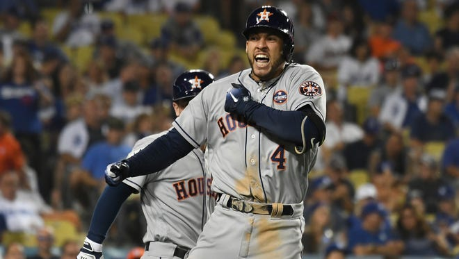 Astros' George Springer celebrates after hitting a two-run home run in the 11th inning.