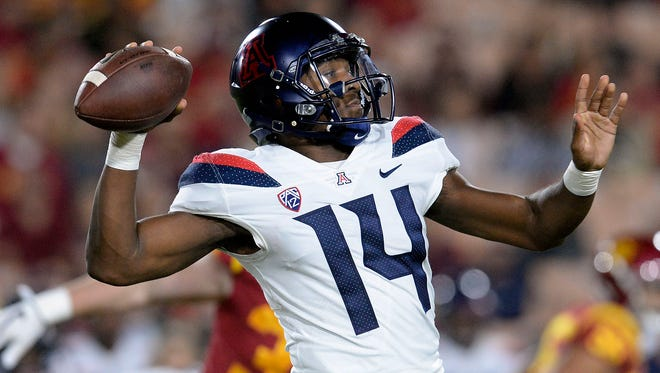 Arizona Wildcats quarterback Khalil Tate (14) throws against the Southern California Trojans during the first half at the Los Angeles Memorial Coliseum.