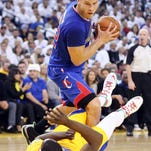 Los Angeles Clippers power forward Blake Griffin (32) is called for an offensive foul against Golden State Warriors small forward Draymond Green (23).