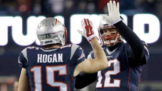 Patriots wide receiver Chris Hogan and quarterback Tom Brady before their divisional playoff game against the Texans last month.