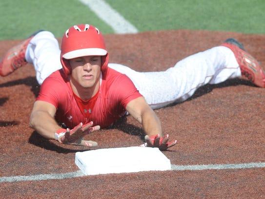 Albany's Hunter Owen slides safely into third base