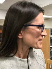 New Chairwoman of the Burlington School Board School District Clare Wool talks with community members following a Special Meeting and swearing in at Hunt Middle School on April 3, 2018.