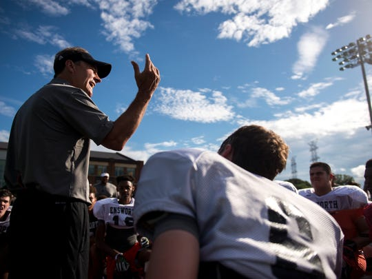 Ensworth football Coach Ricky Bowers speaks to his team during practice at Ensworth High School, Wednesday, Aug. 17, 2016, in Nashville, Tenn.