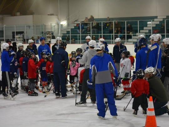 Young, aspiring hockey players mingle with Salem varsity