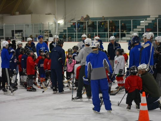 Young, aspiring hockey players mingle with Salem varsity players on Saturday afternoon at PCC.