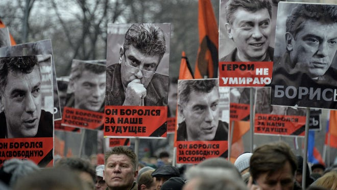 Russia's opposition supporters carry portraits of Kremlin critic Boris Nemtsov during a march in central Moscow on March 1, 2015.