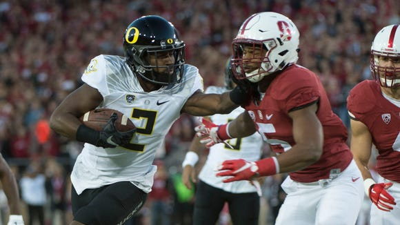 November 14, 2015; Stanford, CA, USA; Oregon Ducks wide receiver Bralon Addison (2) runs with the football against Stanford Cardinal safety Kodi Whitfield (5) during the first quarter at Stanford Stadium. Mandatory Credit: Kyle Terada-USA TODAY Sports