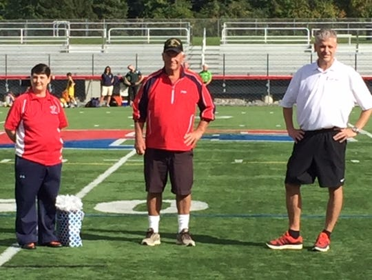 Bob Longhouse, middle, was honored at Fairport's girls