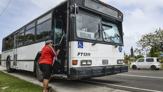 In this April 14 file photo, A Guam Mass Transit customer boards a Red Line bus at the Paseo Loop.
