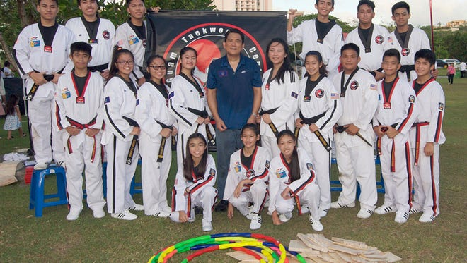 The all-black-belt team of the Guam Taekwondo Center after a demonstration at Gov. Joseph Flores Beach Park during the Pista Sa Nayon. Pictured, first row from left:  Sam Lorzano, Mika DelosSantos and Stephanie Lachica. Second row:  Justin Mariano, Clarisse Palaganas, Charisse Palaganas, Kristelle Cefre, Master Noly Caluag (chief instructor), Michelle Caluag, Kameron Delos Santos, DJ DelaRosa, Kendrick Tahimik and Darryl DelaCruz; and third row: Jake Piano, BJ Reyes, Edward DelaCruz, Jed Caluag, Shawn Balinas and Ryan Gaza.