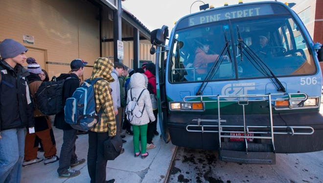 A Chittenden County Transit Authority bus picks up passengers in March 2014. Green Mountain Transit, which includes CCTA, has received a federal grant to replace 10 aging buses.