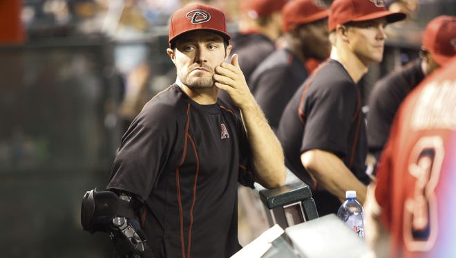Arizona Diamondbacks' A. J. Pollock stands in the dugout watching the game while he recovers from an elbow injury as the Arizona Diamondbacks face off against the Pittsburgh Pirates on Sunday, April 24, 2016, at Chase Field in Phoenix, Ariz.
