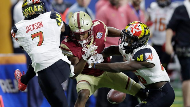 Maryland defensive backs JC Jackson (7) and Darnell Savage Jr. knock the ball away from Boston College wide receiver Jeff Smith during the first half of the Quick Lane Bowl NCAA college football game, Monday, Dec. 26, 2016, in Detroit. (AP Photo/Carlos Osorio)