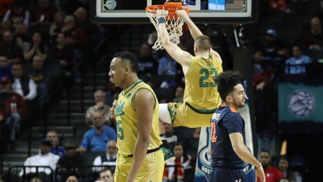 Mar 9, 2017; Brooklyn, NY, USA; Virginia Cavaliers guard London Perrantes (32) and Notre Dame Fighting Irish forward Bonzie Colson (35) react to a dunk by Notre Dame forward Martinas Geben (23) during the first half during the ACC Conference Tournament at Barclays Center. Mandatory Credit: Anthony Gruppuso-USA TODAY Sports