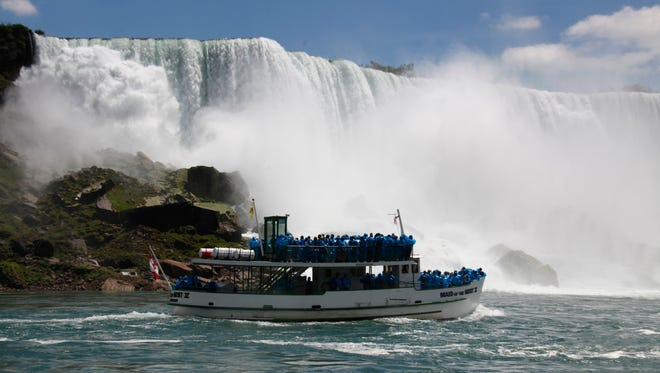 FILE--In this Friday, June 11, 2010 file photo, tourists ride the Maid of the Mist tour boat at the base of the American Falls in Niagara Falls, N.Y.