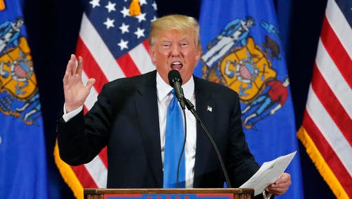 Republican presidential candidate, Donald Trump, reads The Snake poem during a rally at Nathan Hale High School, Sunday, April 3, 2016, in West Allis, Wis. (AP Photo/Charles Rex Arbogast)