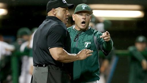 In this April 15, 2016 photo, Tulane baseball coach David Pierce argues an overturned fair ball during an NCAA college baseball game against Cincinnati at Turchin Stadium in New Orleans. Texas reached an agreement Wednesday with Tulane baseball coach David Pierce to take over the Longhorns' program, a person with knowledge of the decision said.