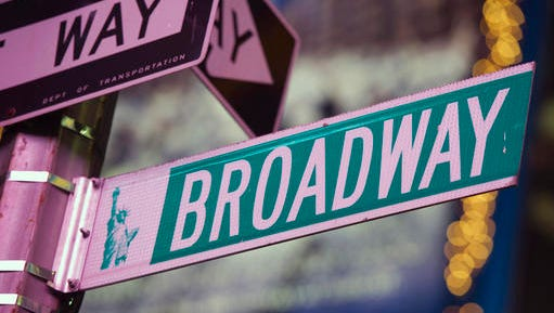 """FILE - This Jan. 19, 2012 file photo shows a Broadway street in Times Square, in New York. Broadway box offices failed to break any records over the Christmas week holiday, despite mild weather and eye-popping hauls by huge hits like """"Hamilton."""" Revenues, attendance and the number of shows all dipped."""