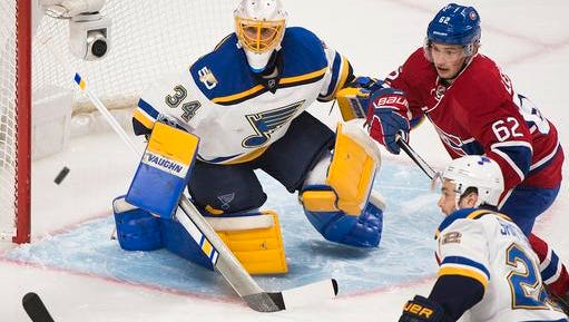 Montreal Canadiens left wing Artturi Lehkonen (62) moves in on St. Louis Blues goalie Jake Allen (34) as defenseman Kevin Shattenkirk (22) looks for the puck during the first period of an NHL hockey game Saturday, Feb. 11, 2017, in Montreal. (Graham Hughes/The Canadian Press via AP)