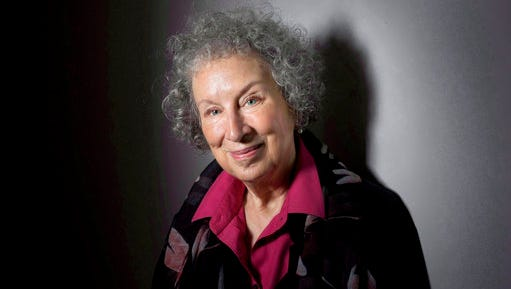 "FILE - In this June 9, 2015 file photo, author Margaret Atwood poses to promote her novel, ""The Heart Goes Last"" in Toronto. The Canadian author has provided additional material for a special audio edition of ""The Handmaid's Tale,"" coming out next week exclusively from Audible.com. The audiobook expands upon a version released in 2012 and narrated by Claire Danes. Atwood's novel, as related through a handmaid known as ""Offred,"" imagines a dystopian society named Gilead in which women have lost their rights and even their identities."