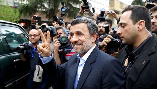 Former Iranian President Mahmoud Ahmadinejad flashes the victory sign as he arrives at the Interior Ministry to register his candidacy for the upcoming presidential elections, in Tehran, Iran, Wednesday, April 12, 2017. Ahmadinejad on Wednesday unexpectedly filed to run in the country's May presidential election, contradicting a recommendation from the supreme leader to stay out of the race.