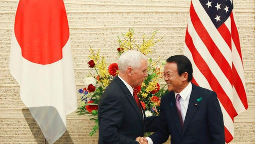 "U.S. Vice President Mike Pence, left, and Japanese Deputy Prime Minister and Finance Minister Taro Aso shake hands as they end the joint press conference at the prime minister's office in Tokyo, Tuesday, April 18, 2017. After meeting with Japanese Prime Minister Shinzo Abe, Pence held talks with Aso on a new U.S.-Japan ""economic dialogue"" to be led by the two. The new forum for trade talks was launched by U.S. President Donald Trump and Abe during the Japanese leader's visit to the U.S. in February."