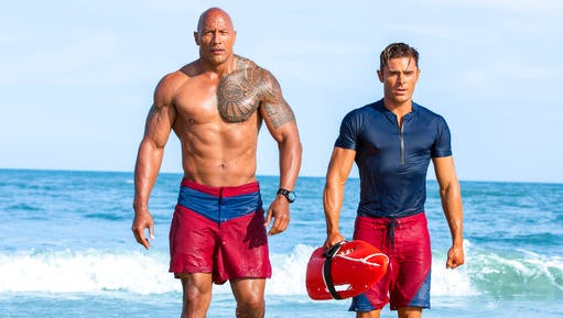 """Dwayne Johnson, Left, and Zac Efron star in """"Baywatch,"""" in theaters May 25."""