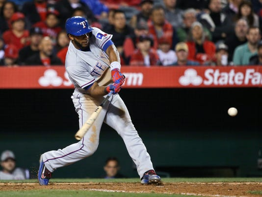 Texas Rangers' Elvis Andrus drills a base hit to left field to drive in Ian Desmond against the Los Angeles Angels during the seventh inning of a baseball game Friday, April 8, 2016, in Anaheim, Calif. (AP Photo/Lenny Ignelzi)
