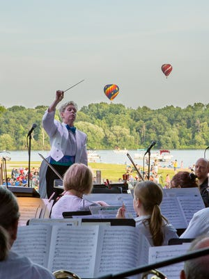 "Nan Washburn and the Michigan Philharmonic play the orchestra's annual patriotic concert, ""An American Salute,"" Saturday, July 1, at 7 p.m. in downtown Plymouth's Kellogg Park."