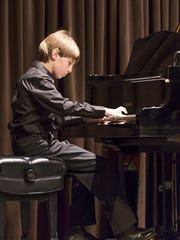 """JAM XV, the6th Annual Kretzer Piano's """"Music for the Mind"""" Concert, will raise money forscholarships for18 students. Pictured is a student playing the piano in last year's performance."""