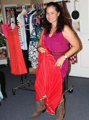 Mindi Fetterman, executive director of the Inner Truth Project, goes through clothes for the fifth annual Fall into Fashion Clothing Swap. Mark your calendars now for Oct. 14 as the party begins at 5 p.m. at 2190 Reserve Park Trace #13 in Port St. Lucie.