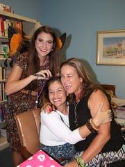 Chloe Miller, left, Mindi Fetterman and Deb Pizzimenti