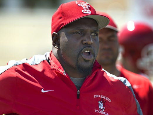The  former University of  Florida Gators and Tampa Bay Buccaneers running back Earnest Graham addesses his new team  during his first day of coaching the North Fort Myers High School Red Knights, Monday.