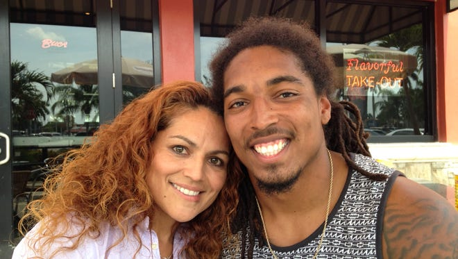 Former North Fort Myers and North Carolina star Tre Boston poses with his mother, Iris De Hoyos, outside of the Edison Mall after he was drafted by the Panthers on Saturday.