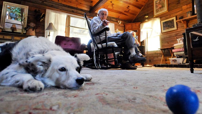 John Pilley talks about his dog Chaser, a 9-year-old border collie who knows 1,000 words, alongside his wife Sally at their home in Spartanburg, S.C., on Tuesday, Nov. 12, 2013.